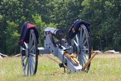 Cannon and uniforms Royalty Free Stock Images