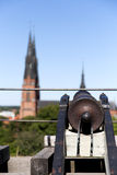 Cannon in Uppsala, Sweden. Cannon in Uppsala castle pointing at the cathedral Royalty Free Stock Photography