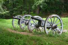 Cannon at Valley Forge. 2 Vintage Cannon sitting side by side in a green meadow with trees in the background at Valley Forge royalty free stock images