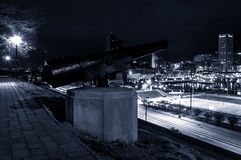 Cannon and view of the Baltimore Skyline at night on Federal Hil Royalty Free Stock Image