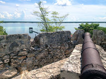 Cannon on the wall of the fort of San Felipe in Bacalar Lagoon Stock Photo