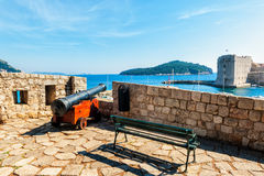 Cannon on the walls of old city of Dubrovnik overlooks the sea Royalty Free Stock Photography