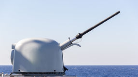 Cannon of a warship aims to target Stock Photography