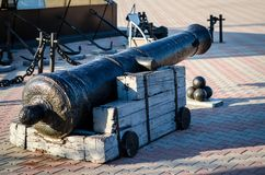 Cannon on wheels, with cores. Horizontal frame royalty free stock images