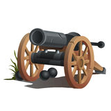 Cannon on wooden wheels and black cannonballs. Antique weapons Royalty Free Stock Image