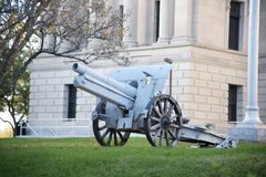 Cannonball Gun in front of a courthouse Royalty Free Stock Images