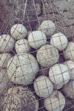 Cannonballs in Fortress. Stone cannonballs in a cage on Fortress Royalty Free Stock Photo