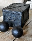 Cannonballs and old crate Royalty Free Stock Photo