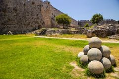 Cannonballs outside the fortress, Rhodes, Greece. Many cannonballs outside the fortress, Rhodes, Greece Royalty Free Stock Photo