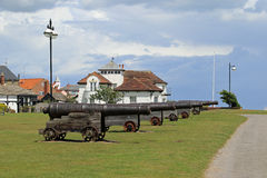 Cannons at Gun Hill. On Gun Hill, overlooking the sea you could not fail to be impressed by the eighteen pound cannons. It is said these guns were given to the Stock Images