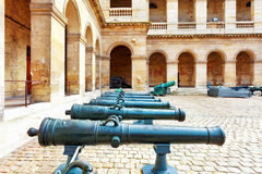 Cannons (guns) in courtyard of Les Invalides hotel . Paris, Fran Stock Photography
