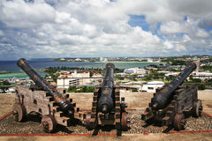 Cannons in Hagatna Bay Guam. Cannons in Fort Santa Agueda overlooking downtown Guam Stock Images