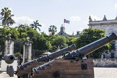 Cannons in Historic Cuban Fort. With the Flag waving in the background Stock Photography