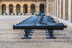 Cannons at Les Invalides museum complex in Paris, France burial site for France`s war heroes and emperor Napoleon Bonaparte`s tomb. Detail of old cannons at the royalty free stock photo
