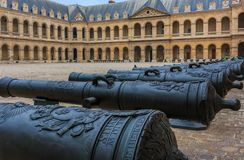 Cannons at Les Invalides museum complex in Paris, France burial site for France`s war heroes and emperor Napoleon Bonaparte`s tomb. Detail of old cannons at the royalty free stock photos
