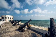 Cannons line the cape coast castle. Old cannons lines the cape coast castle in Ghana Africa stock images