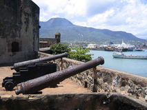 Cannons at Old Caribbean Fortress. Cannons at San Felipe Fortress overlooking Puerto Plata port, Dominican Republic Stock Image