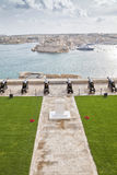 Valletta Canons. Cannons overlooking the Valletta Grand Harbor, Malta on Remembrance Day with the memorial in the foreground Stock Photography