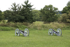 Cannons Sitting in a Field Royalty Free Stock Photography