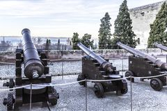 Cannons somewhere in the Alhambra with trees and a hill in the background stock images