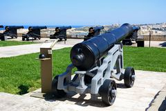 Cannons in Upper Barrakka gardens, Valletta. Cannons in Upper Barrakka Gardens with views across the harbour towards Vittoriosa, Valletta, Malta, Europe Stock Photos