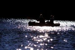 Canoë au coucher du soleil Photos libres de droits