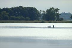 Canoa con los pescadores Imagen de archivo libre de regalías