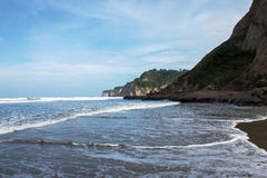 Canoa,Ecuador. High tide and cliffs in tourist village on the Pacific coast of Ecuador Stock Images