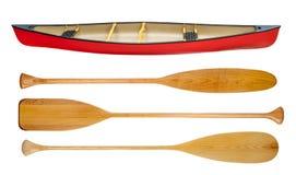 Canoa y paletas de madera aisladas Fotografía de archivo libre de regalías