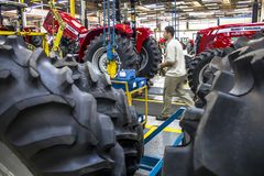 Factory of Massey Fergusson tractor production line at AGCO agricultural machinery plant. Canoas, Rio Grande do Sul, October 03, 2013. Factory of Massey royalty free stock photography