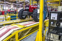 Factory of Massey Fergusson tractor production line at AGCO agricultural machinery plant. Canoas, Rio Grande do Sul, October 03, 2013. Factory of Massey royalty free stock image