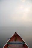 Canoe. Misty morning with canoe Stock Photos