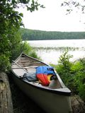 Canoe. With west and paddle Stock Images