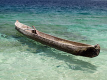 Canoe. On cristal clear tropical water royalty free stock image
