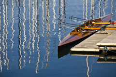 Canoe. A wooden canoe to the dock at the port of Trieste Royalty Free Stock Image