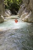 Canoe. Driver on the river in the canyon of Acheron Royalty Free Stock Photos