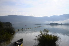 Canoe on Aiguebelette lake in France Royalty Free Stock Photo