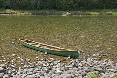 Canoe anchored by river bank Royalty Free Stock Photo