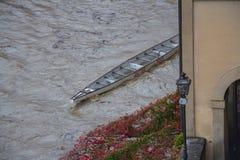 Canoe and Arno river after heavy rain. Florence. Italy. Royalty Free Stock Photo