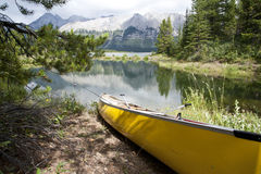 Canoe on the bank of the lake Royalty Free Stock Photography