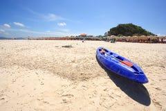 Canoe and Beach. Dark Blue Canoe on a Beautiful Beach. Beach Chair and Colorful Umbrella on the Beach , Phuket Thailand stock images