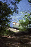 Canoe on beach. Canoe on shore on a northern lake Royalty Free Stock Photography