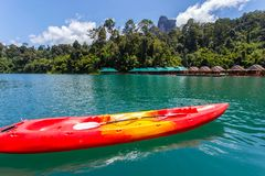 Canoe in a beautiful mountains lake forest and river natural attractions in Ratchaprapha Dam at Khao Sok National Park Royalty Free Stock Image