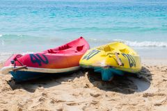 Canoe on the blue sea. Yellow and blue kayaks on the beach on a sunny day. Sports summer hobby, passion Background. There is a. Place for text stock photo
