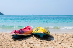 Canoe on the blue sea. Yellow and blue kayaks on the beach on a sunny day. Sports summer hobby, passion Background. There is a royalty free stock image