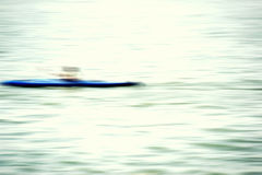 Canoe blurred. The blurred and abstract outlines of a canoe on a river royalty free stock photo
