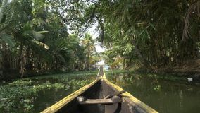 Canoe boat on backwaters of Kerala State, South India stock video footage