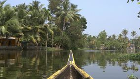 Canoe boat on backwaters of Kerala State, South India stock footage