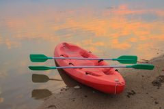 Canoe Boat lying on the beach Stock Photo