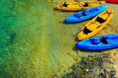 Canoe boats. On a sunny beach Royalty Free Stock Photos